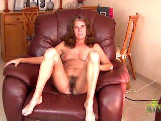 Naked and naughty mature babe has a nice bush