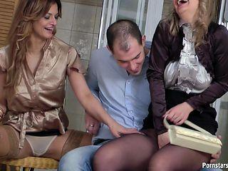 Girls in satin join the guy for a blistering hot group scene