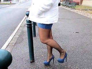 Fashionable blue denim skirts and blue high heels