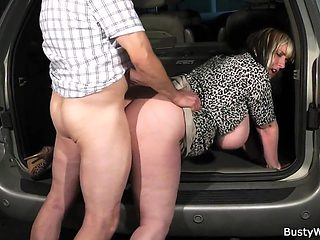Horny boss doggy-fucks busty bitch at work