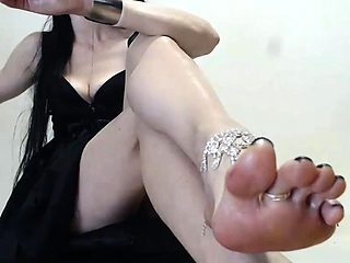 Beauty enjoying foot massage and foot sex