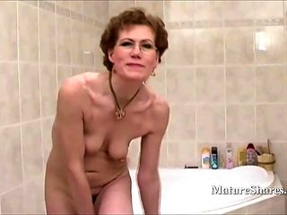 Grandma with Glasses Shaves Her Pussy