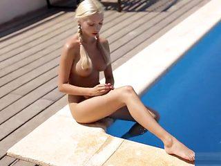 Blonde Outdoor pool workout wearing nike free