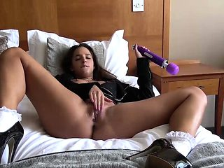 Horny brunette Amirah Adara pleasing herself on bed