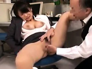 Buxom Oriental secretary has a guy fingering her pussy in t