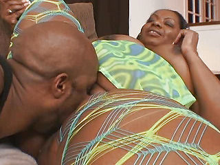 Aunt fucks big black on the couch
