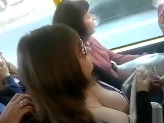 Guy in the bus films young babe's huge rack