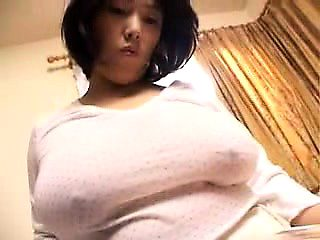Voluptuous Japanese housewife puts her big natural hooters