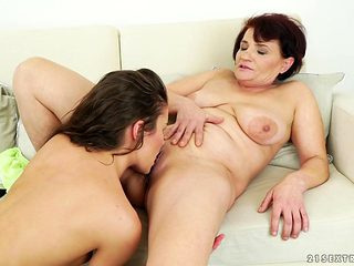 Mature with massive breasts getting nude for your viewing enjoyment in solo action
