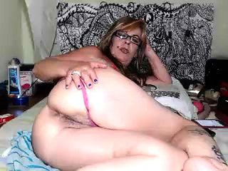 Readhead mature slut solo with her ass