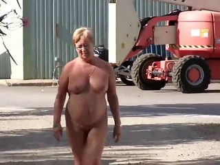Mature woman enjoys walking around completely naked