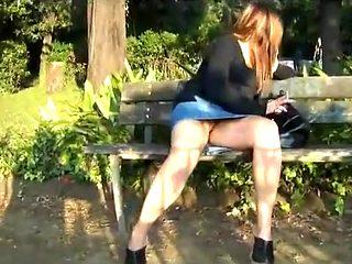 Upskirt of a frisky slut in the park