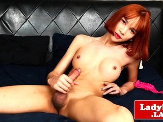 Redhead ladyboy wanks and cums on herself