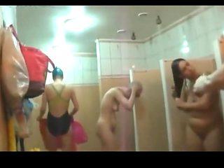 Mature and junior girl sharing shower
