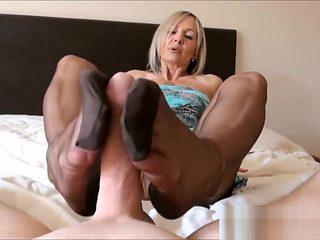 Ala gives nylon foot job and hand job to slave. Denies him orgasm.