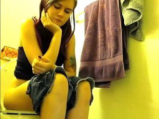 Colorful hair teen pees in bathroom