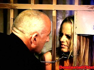 Chained slave beauty fucked from behind