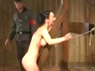 Woman tied and whipped