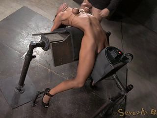 Kinky tart gets bound and fucked by a machine really hard