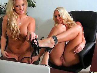 Two gorgeous and stunning blonde girls Katie Banks and Molly Cavalli strip and show their sexy cu...