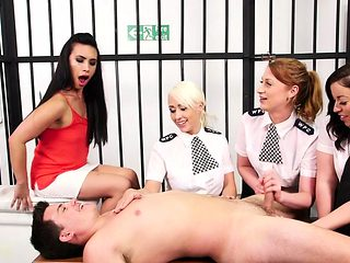 Femdom police officers sharing prisoners dick