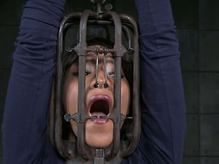 Bald headed sex slave is cuffed and punished in the dungeon