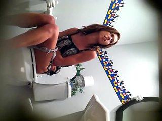 Hot girl in long dress caught peeing