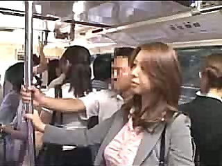 Chick gives a handjob on the bus