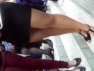 Hidden camera video of a girl in a tight black skirt waitin