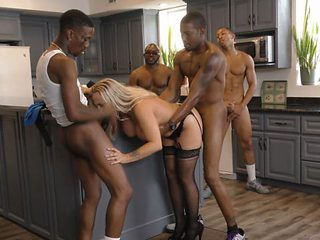 Slutty Cougar Amber Lynn Bach Gets Shared Between Horny Black Men