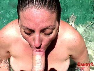 Candy Bangs Sucks A Cock In A Pool