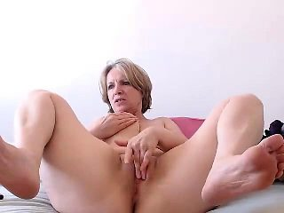 Blonde mature Bridget with big boobs posing