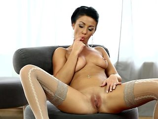 Brunette is horny as hell and fucks her wet spot with her dildo for you to enjoy