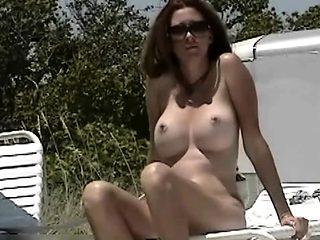 Two hot beach babes crotch shot big tits  voyeur video