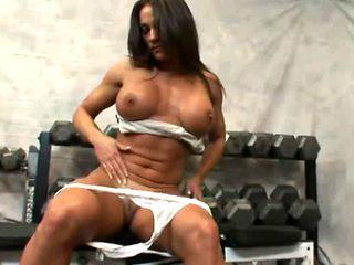 Busty brunette MILF Kristine Madison enjoys a threesome fuck in a gym