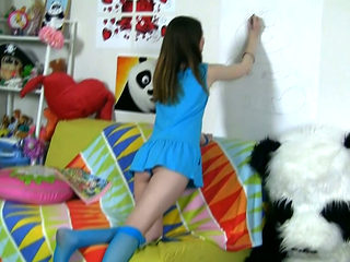 Lovely teen chick Nicki is drawing panda next to her fellow in Panda costume