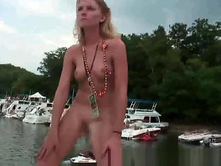 Group of drunk party girls dancing around on a boat