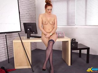 British redhead dazzles with a sexy striptease