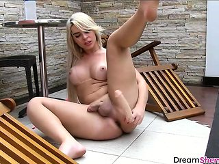 Big ass blonde shemale masturbates with big dildo outdoor