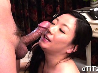Busty asian gives titty fuck and wet oral stimulation