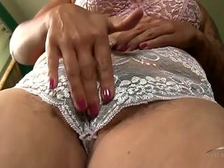 Amateur models her hairy cunt and panties