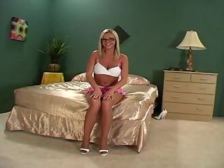 Beautiful blonde with glasses gets load on pantyhose
