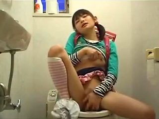 Petite Japanese Teen Sits On The Toilet And Fingers Her Tig