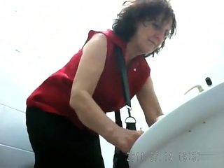 Curvy matures piss in hidden camera porn