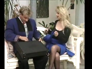 Busty Blonde in stockings gets seduced in the office