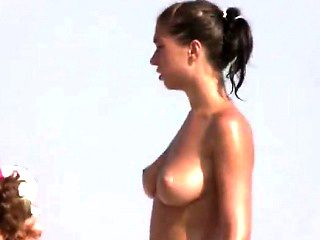 Beach spy cam catches a nudist girl running into the water