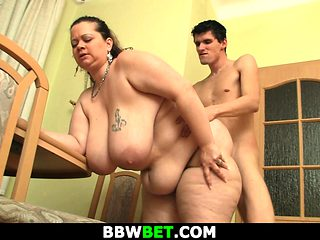 Big-cocked guy fucks huge boobs plumper from behind