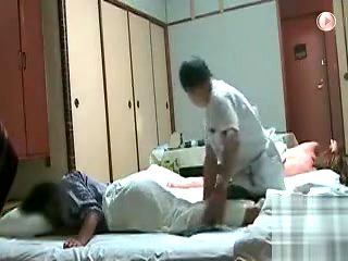 Asian massage with naked girl in the background