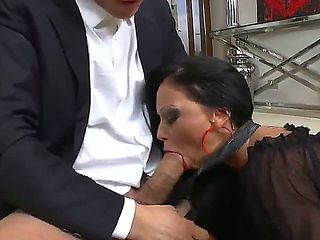 Two hot whores dressed in office suits sucking one cock together, just take a look how this horny...