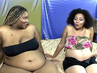 Ebony pregnant chick gets pussy filled by toy
